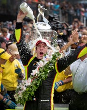 "Simon Pagenuad celebrates after winning the 2019 Indianapolis 500, giving team owner Roger Penske his 18th victory at the ""Greatest Spectacle in Racing."""