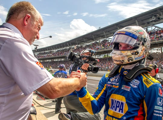 Alexander Rossi (27) of Andretti Autosport  looks dejected as he gets a handshake from Rob Edwards after the 103rd Running of the Indy 500 at the Indianapolis Motor Speedway Museum Sunday afternoon. 5/23/19
