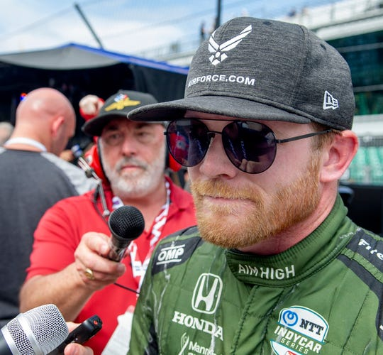 Conor Daly (25) of Andretti Autosport expresses his frustration with IndyCar's decison to put Takuma Sato ahead of him during the red flag at the end of the103rd Running of the Indy 500 at the Indianapolis Motor Speedway Museum Sunday afternoon. 5/23/19