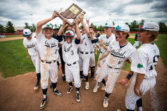 Cathedral celebrates their sectional win at New Palestine High School, Monday, May 27, 2019. Cathedral defeated New Palestine in 7 innings, 10-2 and will advance to semi-state against Greenfield Central or Richmond.
