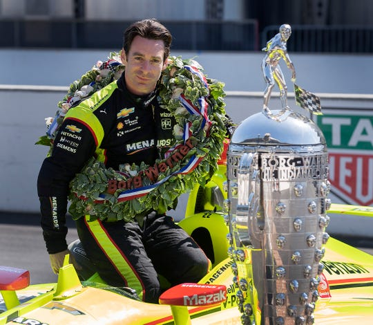 Simon Pagenaud, winner of the 103rd Indianapolis 500, poses for photos on the yard of bricks with the Borg-Warner Trophy at Indianapolis Motor Speedway on Monday, May 27, 2019.
