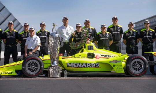 Simon Pagenaud celebrates with his team after winning the 103rd Indianapolis 500.