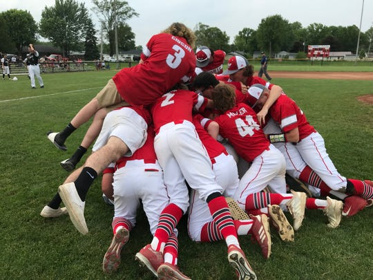 Rossville players form a dogpile after defeating Sheridan 12-0 to win a third straight sectional championship.