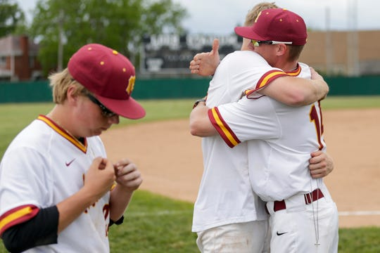 McCutcheon assistant coach Bryan Craig consoles McCutcheon right fielder Connor Ayers (7) after being defeated by Logansport, 9-8, in the 4a baseball Sectional Championship, Monday, May 27, 2019, at Loeb Stadium in Lafayette.