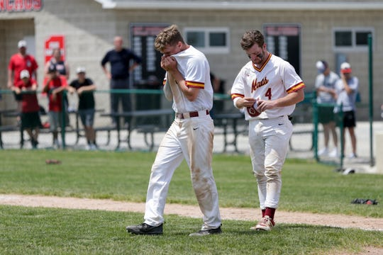 McCutcheon short stop Jarod Smith (5) and McCutcheon catcher Peyton Williams (4) raect after being defeated by Logansport, 9-8, in the 4a baseball Sectional Championship, Monday, May 27, 2019, at Loeb Stadium in Lafayette.