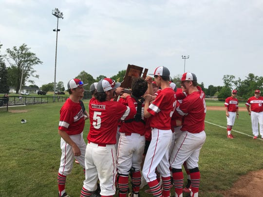 Rossville seniors accept the sectional championship trophy after defeating Sheridan 12-0.