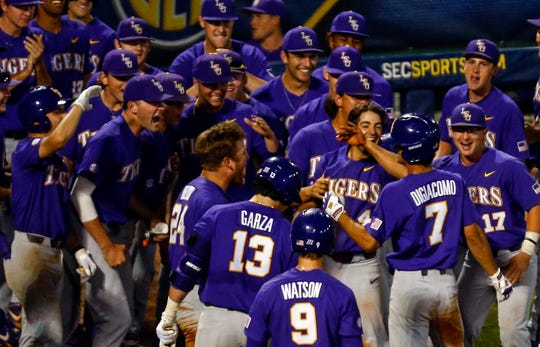 LSU's Giovanni DiGiacomo (7) celebrates with his team after hitting a two-run homer during the eighth inning of the SEC tournament game against Mississippi State in Hoover, Alabama.