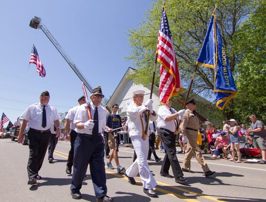 The honor guard passes down the route at the front of the Hartland Memorial Day parade Monday, May 27, 2019.