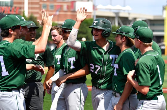 Trinity's Brett Pfaadt (27) is congratulated by teammates after scoring during their 7th region semifinal game against Male at Jim Patterson Stadium. May 27, 2019