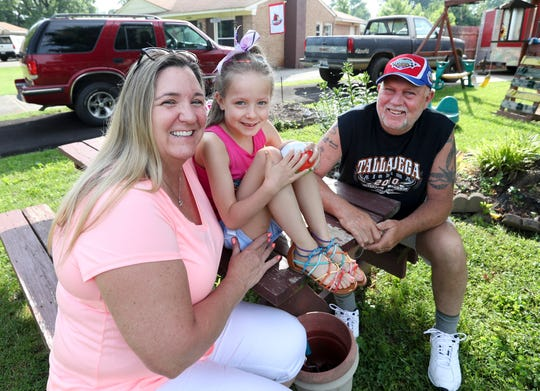 Terry Garvin with his granddaughter Kayleigh-Rae and his girlfriend of 10 years Donna Krieger outside their home on May 25.