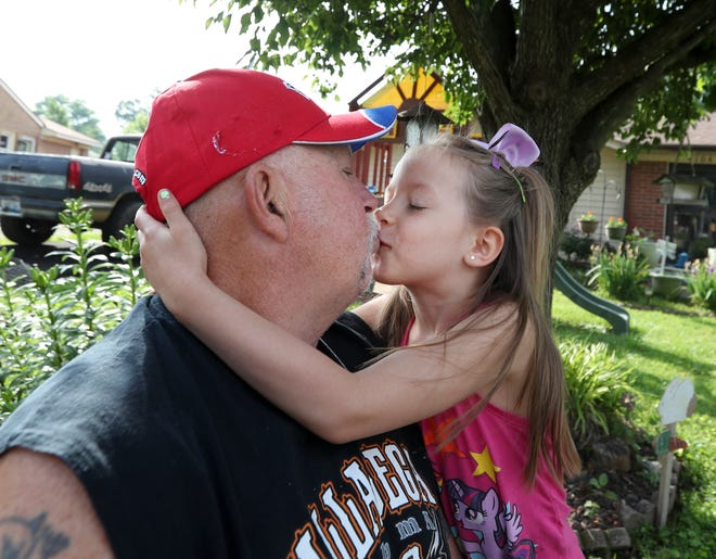 Kayleigh-Rae kissed her grandfather Terry Garvin outside their home on May 25.