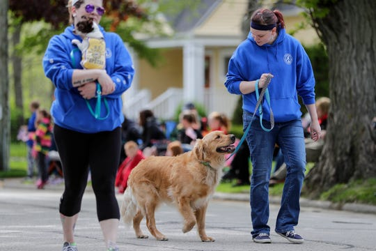 The Lakeshore Humane Society marches during the Memorial Day parade Monday, May 27, 2019, in Manitowoc, Wis.