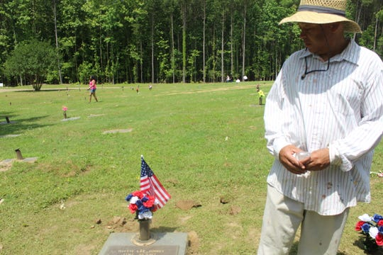 Morris Jones, 54, went to Galilee Memorial Gardens in Bartlett, Tennessee on Memorial Day to honor his uncle and his brother that served in the military.