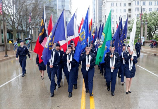 Air Force Junior ROTC members from Greenfield High School march with all 50 state flags during Milwaukee's 154th annual Memorial Day Parade Monday, May 27, 2019. The parade headed down Wisconsin Avenue, ending with a ceremony at the War Memorial and featured color guards, marching bands  and military vehicles.