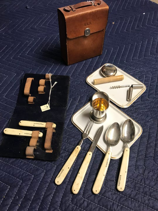 Among the items for sale at Pabst Mansion's June 8 estate sale is a monogrammed leather gentleman's camping case with folding ivory handle utensils, corkscrew and telescoping cups.