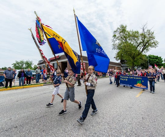 Members of the Pewaukee Cub Scouts Pack 13 march in the Pewaukee Memorial Day parade on Monday, May 27, 2019.