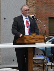 Retired U.S. Army Sgt. 1st Class Michael Dobbs of Bryant served as the guest speaker at the Mountain Home Memorial Day ceremony Monday in downtown Mountain Home.