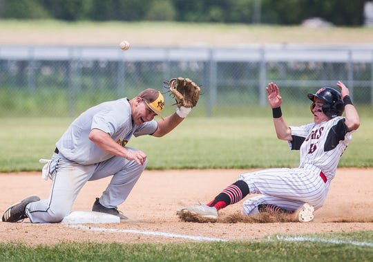 Wapahani's Garrett Stanley slides to third against Monroe Central during their sectional championship game at Lapel High School Monday, May 27, 2019.