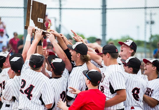 Wapahani celebrates defeating Monroe Central during their sectional championship game at Lapel High School Monday, May 27, 2019.