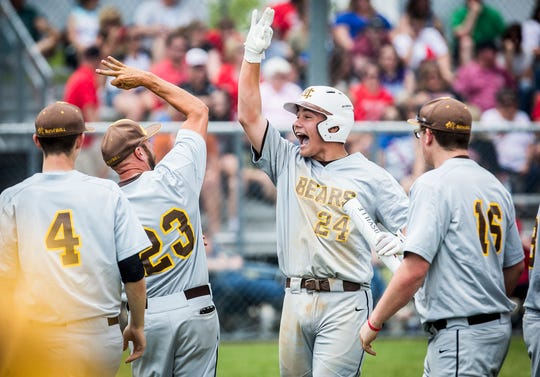 Monroe Central's Joel Kennedy celebrates a run against Wapahani during their sectional championship game at Lapel High School Monday, May 27, 2019.