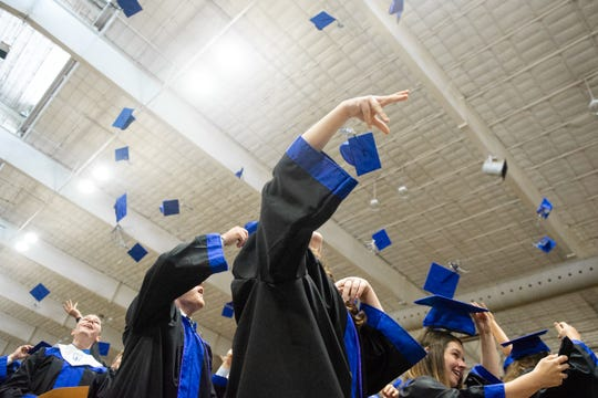 Graduates throw their caps in the air after singing the alma mater during Nolensville High School's graduation ceremony at Williamson County Ag Expo Park Sunday, May 26, 2019, in Franklin, Tenn.