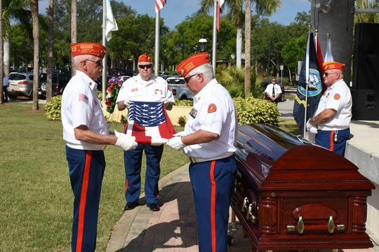 The Marine Corps League honor guard ceremonially folds a U.S. flag. Bonita Springs commemorated Memorial Day on Monday morning, May 27, 2019, with a ceremony at Riverside Park attended by hundreds.