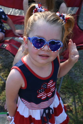 Twins Austin and Lilly Hunter, 4, are decked out in red, white and blue. Bonita Springs commemorated Memorial Day on Monday morning, May 27, 2019,  with a ceremony at Riverside Park attended by hundreds.