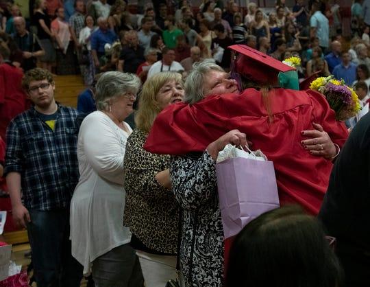 Licking Valley High School graduate Taeya Ireton hugs her proud grandma, Susan Beck, after the graduation ceremony on May 26, 2019.