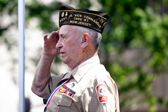 World War II Navy veteran Larry Suther, of Hawthorne, salutes the flag during the singing of the National Anthem during Hawthorne's annual Memorial Day service in front of Borough Hall on Monday, May 27, 2019.