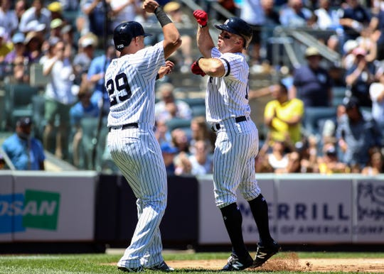 New York Yankees left fielder Brett Gardner (11) is greeted by third baseman Gio Urshela (29) after hitting a two-run home run in the second inning against the San Diego Padres at Yankee Stadium.
