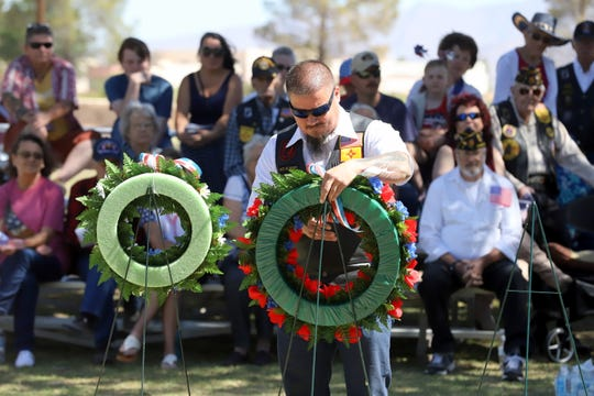 Kenneth Teague presented a wreath in memory of all veterans who gave the ultimate sacrifice during Monday's Memorial Day ceremony at the Mountain View Cemetery.