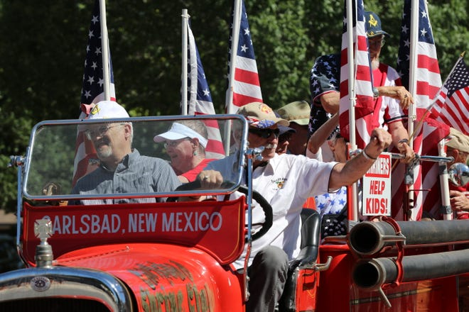 Former judge Dick Van Dyk  in the 2019 Memorial Day parade May 27 in Carlsbad waves to the crowd.
