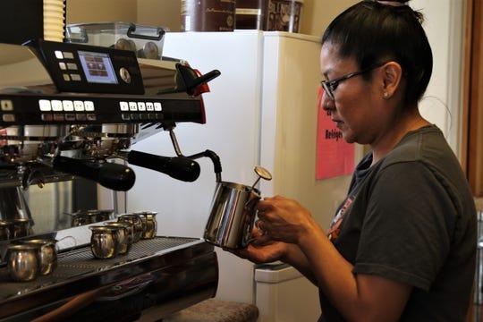Monica Gurule prepares coffee, Thursday, May 23, 2019, at Oso Grande Coffee Company in Farmington.
