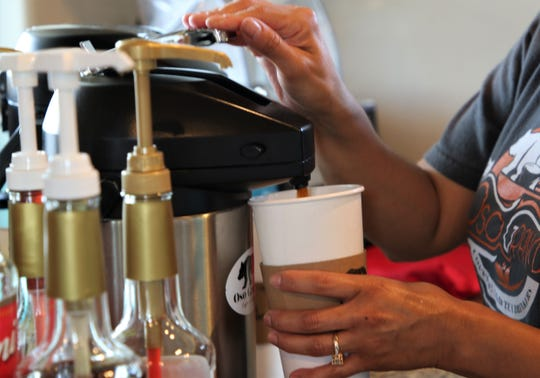 Monica Gurule fills a cup with coffee, Thursday, May 23, 2019, at Oso Grande Coffee Company.