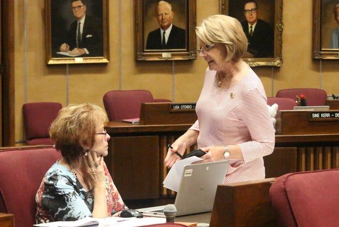 Arizona Senate President Karen Fann, right, confers with fellow Republican Sen. Sylvia Allen in the Senate building in Phoenix ON May 25, 2019.