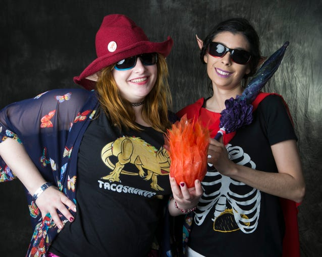 Cassandra Feely dressed as Taako (left) and Rachel Murillo (right) dressed as Lup stand in the Azcentral photo booth during Phoenix Fan Fusion at the Phoenix Convention Center in Phoenix on May 26, 2019.