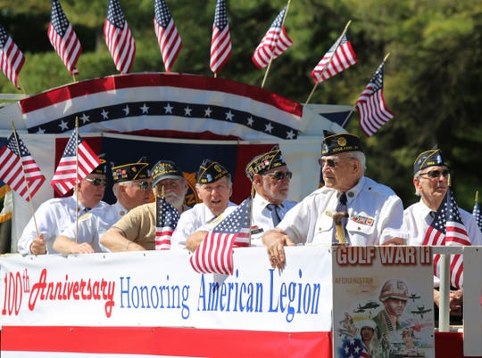 In this May 27, 2019 file photo, the American Legion Hyde Park Post No. 1303 marches in a Memorial Day parade in Hyde Park.