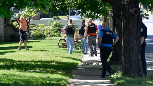 Police from multiple jurisdictions search for a man that fled from a stolen vehicle in the Hill Street and Spahn Avenue area, Monday, May 27, 2019. 
