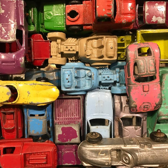 Antique metal toy cars are on display at American Daydream Antiques & Miscellanea.