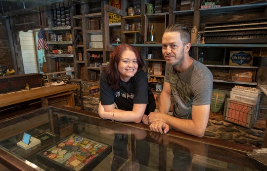 Maria, left, and Greg Koller lean on the front desk of American Daydream Antiques & Miscellanea in Springettsbury Township. The couple spent seven months renovating a barn that was once threatened with demolition.