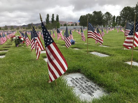 Flags mark the headstone at the Northern Nevada Veterans Memorial Cemetery in Fernley.