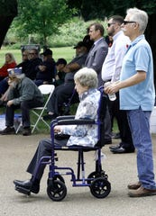 U.S. Navy veteran Mark Boese, right, accompanies his mother, Marilyn Boese, on Monday during a Memorial Day ceremony at Redding Memorial Park.