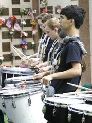 Jonah Lincoln of the Enterprise High School Marching Band plays a set of quad tom drums Monday at a Memorial Day service at Redding Memorial Park.