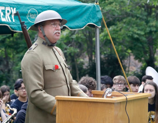 Rob Burroughs, director and curator of the proposedNorthern California Veterans Museum & Heritage Center, speaks during a Memorial Day ceremony Monday at Redding Memorial Park. Burroughs paid tribute to his grandfather, a World War I veteran, by wearing this military uniform from the period.