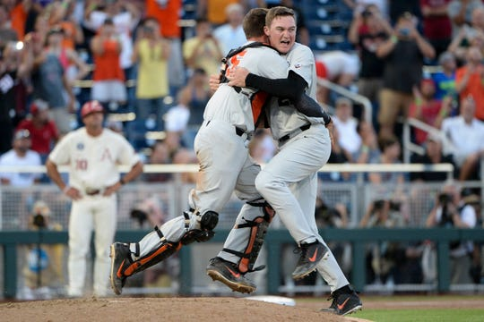 Jun 28, 2018; Omaha, NE, USA; Oregon State Beavers starting pitcher Kevin Abel (right) celebrates with catcher Adley Rutschman (35) after game three of the championship series of the College World Series against the Arkansas Razorbacks at TD Ameritrade Park. Mandatory Credit: Steven Branscombe-USA TODAY Sports