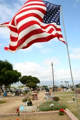The U.S. flag flies as veterans and civilians commemorate Memorial Day in the Soledad Cemetery. May 27, 2019.