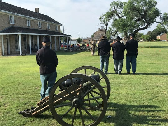 Members of the Fort Concho Living History Program listen as speeches are given during a Memorial Day exercise at Fort Concho National Historic Landmark, 630 S. Oakes St., Monday, May 27, 2019.