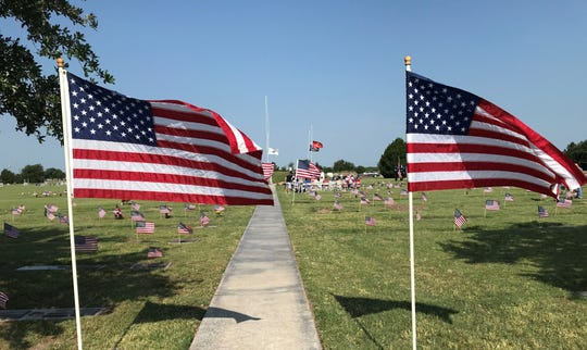 U.S. Flags line a walkway during a Memorial Day event at Johnson's Lawnhaven Memorial Gardens, 4989 FM Highway 1223, Monday, May 27, 2019.