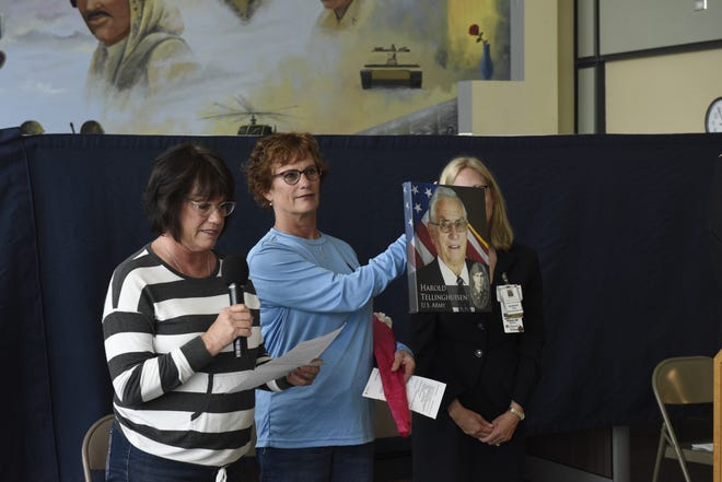 Sally Putzke (left) and Pam VerMulm (right) talk about their father, Harold Tellinghuisen, on Monday, May 27, 2019, as part of a Memorial Day ceremony at  the Sioux Falls VA Medical Center.