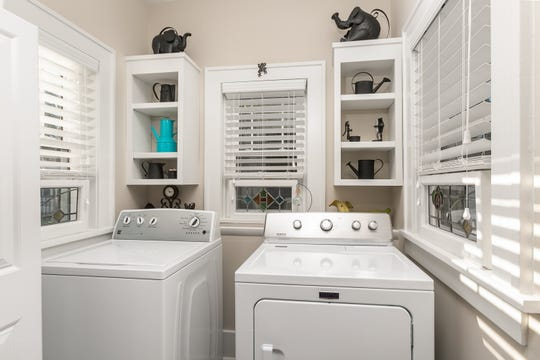 The Paulys transformed a breakfast nook into a bright, airy laundry room. The thought was to move the laundry out of the basement in preparation for the years when it would be best to have everything on one level.